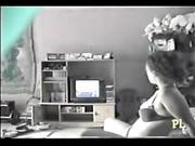 Sweet milf in bra watching TV and masturbating hotly