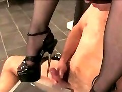 slave getting high heel sounding from mistress