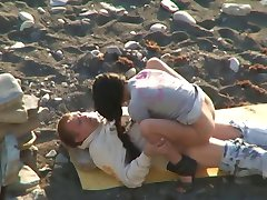 Voyeur Couple On Beach