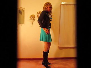 Leather jacket and short skirt with boots.