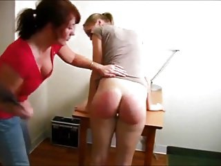 Mom enjoys spanking ass !
