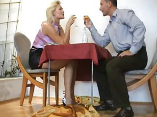 Russian blonde footjob under table at dinner