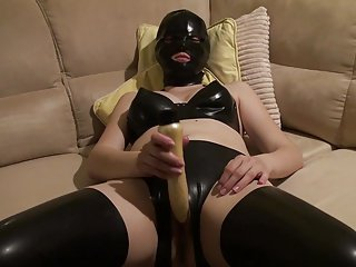Latex Danielle playing with dildo