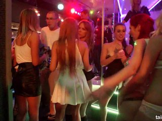 Wet lesbians dancing in the club